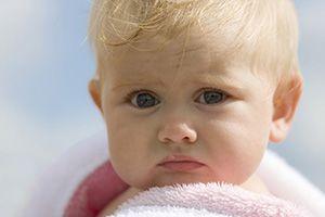 На фото: Герпес на губе у ребенка